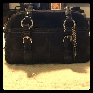 Black cloth Coach purse with large C's.